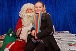 7 year old Niamh Byrne visits Santa in his Grotto in the Drogheda Town Centre..Picture: Shane Maguire / www.newsfile.ie.