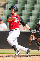 Jim Jacquot #17 of the Kannapolis Intimidators follows through on his swing against the Hickory Crawdads at CMC-Northeast Stadium on April 8, 2012 in Kannapolis, North Carolina.  The Intimidators defeated the Crawdads 12-11.  (Brian Westerholt/Four Seam Images)