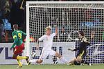 19 JUN 2010: Thomas Sorensen (DEN) (1), Simon Kjaer (DEN) (3) and Samuel Etoo (CMR) (9) as Etoo's shot hits the post. The Denmark National Team defeated the Cameroon National Team 2-1 at Loftus Versfeld Stadium in Tshwane/Pretoria, South Africa in a 2010 FIFA World Cup Group E match.