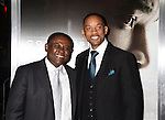 WESTWOOD, CA - NOVEMBER 23:  Dr. Bennet Omalu (L) and actor Will Smith attend the screening of Columbia Pictures' 'Concussion' at the Regency Village Theater on November 23, 2015 in Westwood, California.