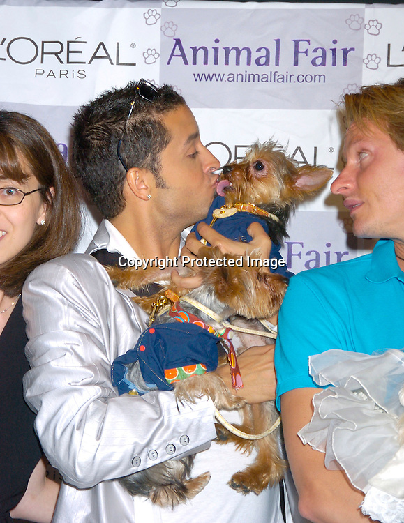 "Jai Rodriguez and  his dogs Nemo and Dory and Carson Kressley ..at Animal Fair's fifth Annual "" Paws for Style"" fashion show to celebrate the 100th year anniversary of the Humane society of New York. The event was on May 24, 2004 at ..Club Black...Photo by Robin Platzer, Twin Images"