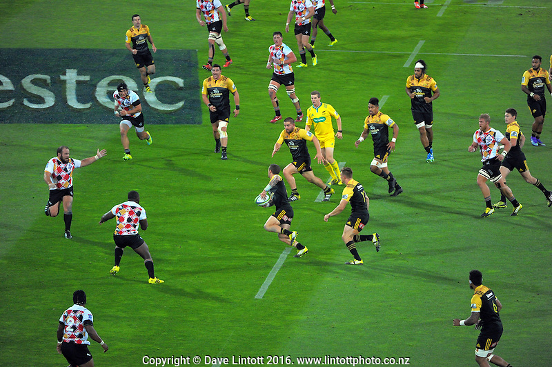 TJ Perenara passes to Dane Coles during the Super Rugby match between the Hurricanes and Southern Kings at Westpac Stadium, Wellington, New Zealand on Friday, 25 March 2016. Photo: Dave Lintott / lintottphoto.co.nz