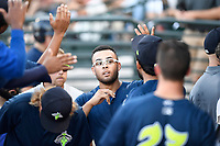 Center fielder Desmond Lindsay (2) of the Columbia Fireflies is congratulated after scoring a run in a game against the Lexington Legends on Thursday, June 8, 2017, at Spirit Communications Park in Columbia, South Carolina. Columbia won, 8-0. (Tom Priddy/Four Seam Images)
