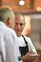 Melbourne, 30 May 2017 - Donovan Cooke from The Atlantic Restaurant talks to Tom Milligan of the Bocuse d'Or Academy Australia at the Australian selection trials of the Bocuse d'Or culinary competition held during the Food Service Australia show at the Royal Exhibition Building in Melbourne, Australia. Photo Sydney Low