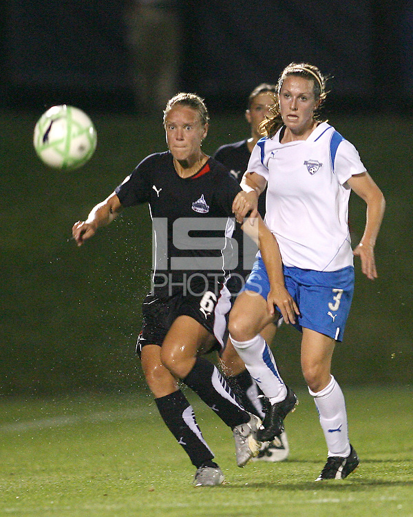 Lori Lindsey #6 of the Washington Freedom sends off a pass in front of Nancy Augustyniak Goffi #25 of the Boston Breakers during a WPS match at Maryland Soccerplex on July 29, in Boyds, Maryland. Freedom won 1-0.
