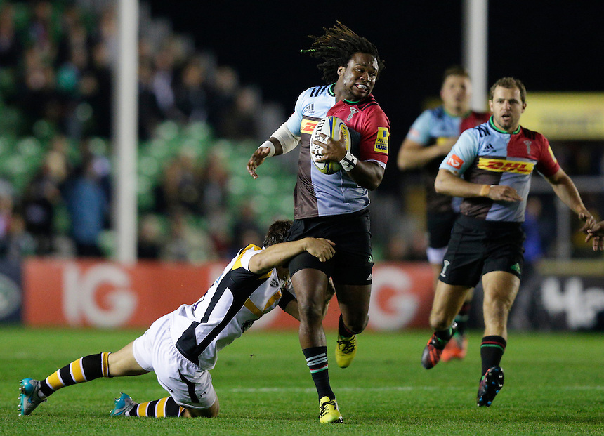 Harlequins' Marland Yarde is tackled by Wasps' Rob Miller <br /> <br /> Photographer Craig Mercer/CameraSport<br /> <br /> Rugby Union - Aviva Premiership - Harlequins v Wasps - Friday 16th October 2015 - The Stoop - London<br /> <br /> &copy; CameraSport - 43 Linden Ave. Countesthorpe. Leicester. England. LE8 5PG - Tel: +44 (0) 116 277 4147 - admin@camerasport.com - www.camerasport.com