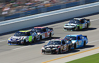 Dale Earnhardt Jr (88) pushes Jimmie Johnson (48) outside of Ryan Newman (39) and Denny Hamlin (11) as Carl Edwards trails during the Aaron's 499 at Talladega Superspeedway, Talladega, AL, April 17, 2011.  (Photo by Brian Cleary/www.bcpix.com)