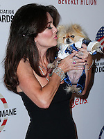 BEVERLY HILLS, CA, USA - SEPTEMBER 27: Lisa Vanderpump and Giggy arrive at the 4th Annual American Humane Association Hero Dog Awards held at the Beverly Hilton Hotel on September 27, 2014 in Beverly Hills, California, United States. (Photo by Xavier Collin/Celebrity Monitor)