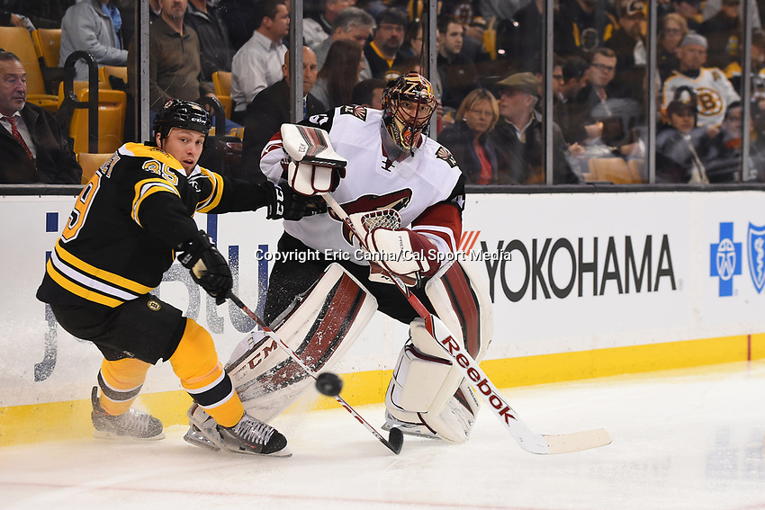 Tuesday, October 27, 2015: Arizona Coyotes goalie Mike Smith (41) works to clear the puck under pressure from Boston Bruins left wing Matt Beleskey (39) during the National Hockey League game between the Arizona Coyotes and the Boston Bruins held at TD Garden, in Boston, Massachusetts. Eric Canha/CSM