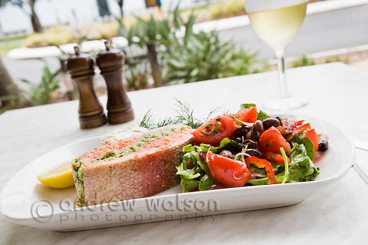 Herb-stuffed salmon with garden salad at Villa Romana Trattoria.  Esplanade, Cairns, Queensland, Australia