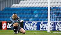 29 APR 2009 - LONDON,GBR -  Loughborough University goalkeeper David Coombes consoles himself during the 2009 BUCS Mens Football Championship Final penalty shootout against UWE Hartpury. (PHOTO (C) NIGEL FARROW)
