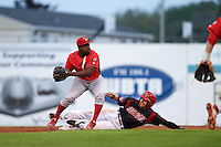 Williamsport Crosscutters second baseman Josh Tobias (33) attempts to turn a double play as Alex Fernandez (46) slides in during a game against the Batavia Muckdogs on August 29, 2015 at Dwyer Stadium in Batavia, New York.  Williamsport defeated Batavia 7-3.  (Mike Janes/Four Seam Images)