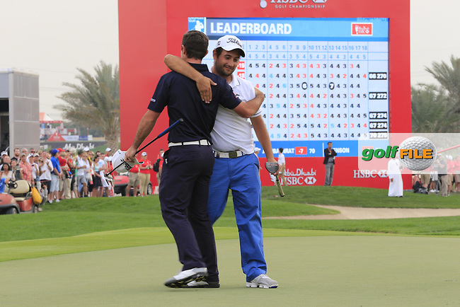 Alexander Levy congratulates fellow countryman Gary Stal (FRA) after he wins his maiden European Tour victory by 1 shot during Sunday's Final Round of the Abu Dhabi HSBC Golf Championship 2015 held at the Abu Dhabi Golf Course, United Arab Emirates. 18th January 2015.<br /> Picture: Eoin Clarke www.golffile.ie
