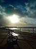 A bench on Aberystwyth Promenade with a splendid view out into Cardigan Bay.<br />