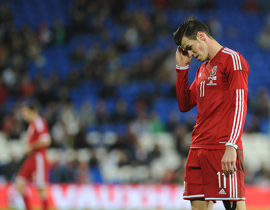 Wales Gareth Bale with his head in his hands after a bad pass <br /> <br /> Photo by Ashley Crowden/CameraSport<br /> <br /> Football - International Friendly - Wales v Finland - Saturday 16th November 2013 - Cardiff City Stadium - Cardiff<br /> <br /> &copy; CameraSport - 43 Linden Ave. Countesthorpe. Leicester. England. LE8 5PG - Tel: +44 (0) 116 277 4147 - admin@camerasport.com - www.camerasport.com