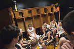 November 23, 2011- Tuscola, IL- The Tuscola Warrior Boys Varsity team hangs out near their new wooden lockers which were made from former wood planks off of the bleachers at TCHS. [Photo: Douglas Cottle]