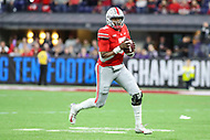 Indianapolis, IN - December 1, 2018: Ohio State Buckeyes quarterback Dwayne Haskins (7) rolls out to throw a pass during the Big Ten championship game between Northwestern  and Ohio State at Lucas Oil Stadium in Indianapolis, IN.   (Photo by Elliott Brown/Media Images International)