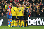 Arsenal's Pierre-Emerick Aubameyang along with his team mates look towards the big screen which shows the challenge that he is sent off for during the Premier League match at Selhurst Park, London. Picture date: 11th January 2020. Picture credit should read: Paul Terry/Sportimage