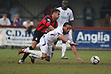 Kaid Mohamed of Wimbledon battles with Antonio Murray of Histon during the Blue Square Bet Premier match between Histon and AFC Wimbledon at the Glass World Stadium, Histon on 16th April, 2011.© Kevin Coleman 2011.