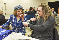 NWA Democrat-Gazette/FLIP PUTTHOFF <br /> AROMATIC OILS<br /> Laurie Allen of Avoca and her son, Jeremiah Allen, sniff a samples of fragrant oil on Tuesday March 12 2019 during a presentation on essential oils at the Rogers Public Library. Kristin Jones with the library staff gave the program on various oils and their uses, including lavender, francincense and lemon oil. The program was featured at the library's monthly Lunch and Learn gathering. Lunch and Learn takes place the second Tuesday of each month from noon to 1 p.m. Friends of the Rogers Public Library sponsor Lunch and Learn.
