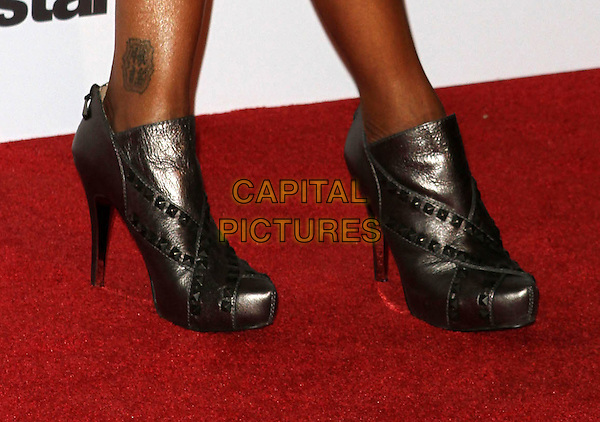 BRANDY's shoes (Brandy Rayana Norwood)  .'Dancing With The Stars' 200th Episode held at Boulevard 3, Hollywood, CA, USA..November 1st, 2010.feet heels detail tattoo ankle boots bronze .CAP/ADM/FS.©Faye Sadou/AdMedia/Capital Pictures.