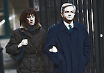 """Caught in the headlights""   -  Chris Huhne and Carina Trimmingham, his partner,  arrive at Southwark Crown Court today 4.2.13..Glare of media flashes lights up the embattled couple as they arrive...She and her former husband MP Chris Huhne are charged with perverting the course of justice....Vasiliki Pryce, née Courmouzis, is an economist, and former Joint Head of the United Kingdom's Government Economic Service......Pic by Gavin Rodgers/Pixel 8000 Ltd"