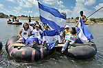 Women from Nicaragua hold photos of their disappeared family members during a December18, 2013 demonstration in the middle of the Suchiate River where it forms a border between Guatemala and Mexico. <br /> <br /> The women were part of a caravan of 45 people from Central America who spent 17 days touring 14 Mexican states in search of their loved ones, most of whom had disappeared while following the migrant trail north. In addition to searching for clues to the fate of their loved ones, they called on the Mexican government to improve its treatment of migrants transiting the country.