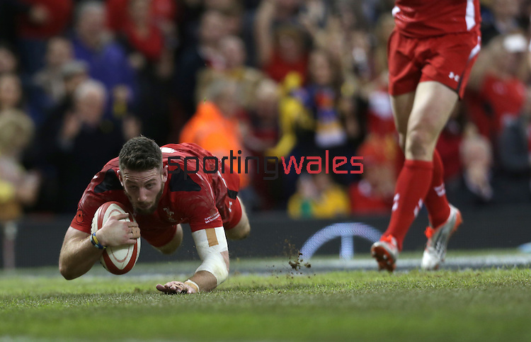 Wing Alex Cuthbert dives over to score Wales second try of the match.<br /> Dove Men Series 2014<br /> Wales v Australia<br /> Millennium Stadium<br /> 08.11.14<br /> ©Steve Pope-SPORTINGWALES