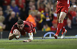 Wing Alex Cuthbert dives over to score Wales second try of the match.<br /> Dove Men Series 2014<br /> Wales v Australia<br /> Millennium Stadium<br /> 08.11.14<br /> &copy;Steve Pope-SPORTINGWALES