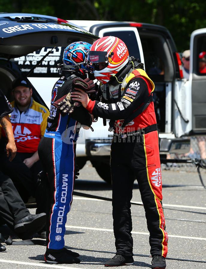 Jun 7, 2015; Englishtown, NJ, USA; NHRA top fuel driver Antron Brown (left) greets Doug Kalitta during the Summernationals at Old Bridge Township Raceway Park. Mandatory Credit: Mark J. Rebilas-