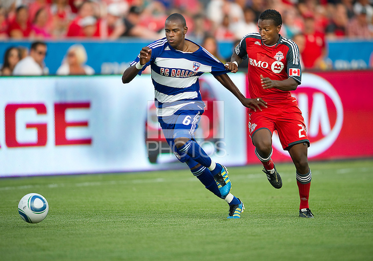 FC Dallas defender/midfielder Jackson Goncalves #6 and Toronto FC defender Danleigh Borman #25 in action during an MLS game between the FC Dallas and the Toronto FC at BMO Field in Toronto on July 20, 2011..FC Dallas won 1-0.