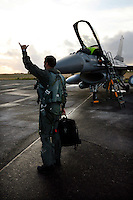 Pilot  greets colleagues after a good flight. Lockheed Martin F-16 Fighting Falcon from Belgian Air Force 349 squadron.  BOLD AVENGER 2007 (BAR 07), a NATO  air exercise at Ørland Main Air Station, Norway. BAR 07 involved air forces from 13 NATO member nations: Belgium, Canada, the Czech Republic, France, Germany, Greece, Norway, Poland, Romania, Spain, Turkey, the United Kingdom and the United States of America. The exercise was designed to provide training for units in tactical air operations, involving over 100 aircraft, including combat, tanker and airborne early warning aircraft and about 1,450 personnel.