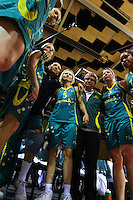 The Opals huddle after the one-sided win during the International women's basketball match between NZ Tall Ferns and Australian Opals at Te Rauparaha Stadium, Porirua, Wellington, New Zealand on Monday 31 August 2009. Photo: Dave Lintott / lintottphoto.co.nz
