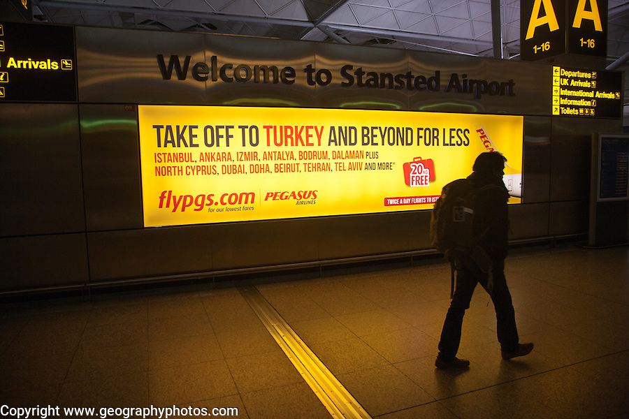 Electronic display advertising for Pegasus airlines flights to Turkey, Stansted airport, Essex, England
