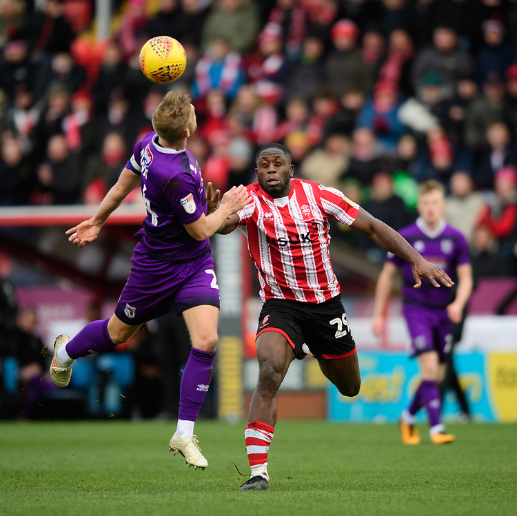 Lincoln City's John Akinde vies for possession with Grimsby Town's Harry Davis<br /> <br /> Photographer Chris Vaughan/CameraSport<br /> <br /> The EFL Sky Bet League Two - Lincoln City v Grimsby Town - Saturday 19 January 2019 - Sincil Bank - Lincoln<br /> <br /> World Copyright &copy; 2019 CameraSport. All rights reserved. 43 Linden Ave. Countesthorpe. Leicester. England. LE8 5PG - Tel: +44 (0) 116 277 4147 - admin@camerasport.com - www.camerasport.com