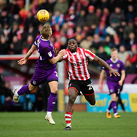 Lincoln City's John Akinde vies for possession with Grimsby Town's Harry Davis<br /> <br /> Photographer Chris Vaughan/CameraSport<br /> <br /> The EFL Sky Bet League Two - Lincoln City v Grimsby Town - Saturday 19 January 2019 - Sincil Bank - Lincoln<br /> <br /> World Copyright © 2019 CameraSport. All rights reserved. 43 Linden Ave. Countesthorpe. Leicester. England. LE8 5PG - Tel: +44 (0) 116 277 4147 - admin@camerasport.com - www.camerasport.com