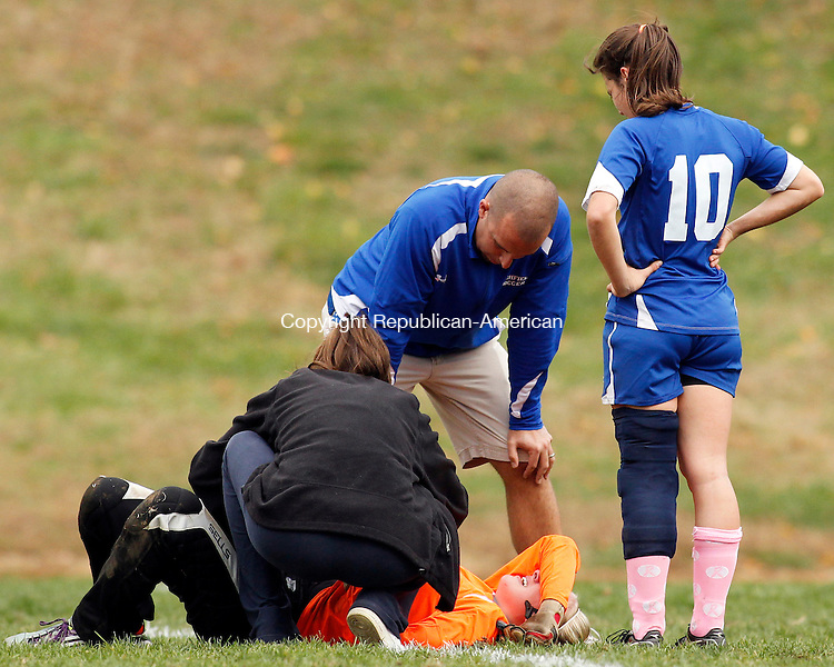 Woodbury, CT- 26, October 2010-102610CM06  Litchfield's Brittany Quinion (#10) watches as goalkeeper, Kelly Lewis grimaces in pain following a collision against Nonnewaug near the goal Tuesday afternoon in Woodbury. Lewis left the game following the injury and was replaced by teammate Emily Andrulis. Christopher Massa Republican-American