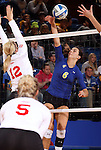 BROOKINGS, SD - OCTOBER 5:  Courtney Roberts #6 from South Dakota State University tries to get a kill past Kendall Krittenbrink #12 from the University of South Dakota in the third game of their match Saturday night at Frost Arena. (Photo by Dave Eggen/Inertia)