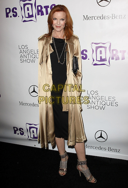 MARCIA CROSS.Opening Night Preview Party of the LA Antique Show Benefiting P.S ARTS held At The Barker Hanger, Santa Monica, California, USA..April 21st, 2010.full length silk satin coat trench mac black dress gold sandals open toe clutch bag  .CAP/ADM/KB.©Kevan Brooks/AdMedia/Capital Pictures.