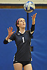 Plainview JFK libero No. 1 Caitlin Trancho serves during a Nassau County varsity girls' volleyball match against Massapequa at Plainview JFK High School on Monday, October 19, 2015. Massapequa won 25-16, 25-8, 25-13.<br /> <br /> James Escher