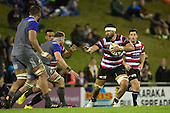 Sootala Fa'asoo'o prepares to fend off Kieran Read. The game of Three Halves, a pre-season warm-up game between the Counties Manukau Steelers, Northland and the All Blacks, played at ECOLight Stadium, Pukekohe, on Friday August 12th 2016. Photo by Richard Spranger.