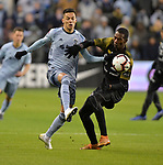 Daniel Salloi of Sporting KC (left) and Abdiel Ayarza of Independiente vie for the ball. Sporting KC hosted Club Atletico Independiente in a CONCACAF Champions League quarterfinal game at Children's Mercy Park on March 14, 2019.