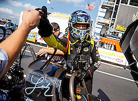 Sep 16, 2016; Concord, NC, USA; NHRA top fuel driver Leah Pritchett fist bumps a crew member prior to climbing into her dragster during qualifying for the Carolina Nationals at zMax Dragway. Mandatory Credit: Mark J. Rebilas-USA TODAY Sports