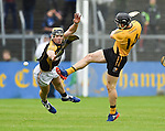 Niall Deasy of Ballyea in action against John Conlon of Clonlara during the senior hurling county final at Cusack park. Photograph by John Kelly.