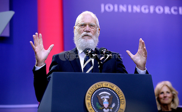 David Letterman speaks on stage at the kick off of the 5th anniversary of Joining Forces and the 75th anniversary of the USO at Joint Base Andrews on May 5, 2016 in Maryland. <br /> Credit: Olivier Douliery / Pool via CNP/MediaPunch