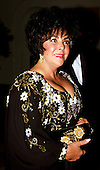 Elizabeth Taylor arrives for the State Dinner honoring Prime Minister Giulio Andreotti of Italy at The White House in Washington, D.C. on March 7, 1990..Credit: Ron Sachs / CNP