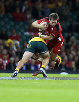 Pictured: Dan Biggar of Wales (L) is brought down by an Australia player Saturday 08 November 2014<br />