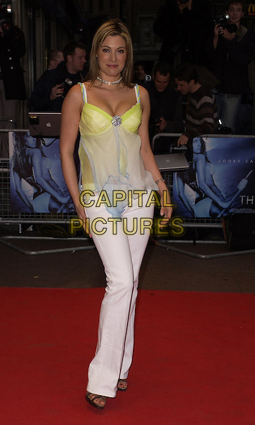 "CATHERINE McQUEEN.World Premiere of ""Three"" at the Odeon West End, Leicester Square, London, UK..May 2nd, 2006.Ref: CAN.full length white jeans yellow blue sheer top.www.capitalpictures.com.sales@capitalpictures.com.©Capital Pictures"