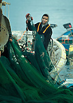 A fisher organizes his nets after a night of fishing off Gaza's coast. Under the 1993 Oslo Peace Accords, the people of Gaza were allowed to fish out to 20 nautical miles from their coastline, yet since the Israeli military imposed a naval blockade in 2007 they have been limited to just three nautical miles. In practice, fishers who venture beyond two nautical miles are shot at by Israeli gunboats; several have been injured and some killed. Despite having 40 kilometers of coastline and a long tradition as fishers, many fishers are unemployed and the people of Gaza are forced to import fish from Israel. And what fishing they can do close to shore mostly involves the harvest of immature fish, which biologists warn has a negative impact on fish stocks in the region....