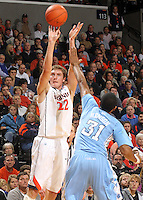 Jan. 8, 2011; Charlottesville, VA, USA;  Virginia Cavaliers forward Will Sherrill (22) shoots over North Carolina Tar Heels forward John Henson (31) during the game at the John Paul Jones Arena. North Carolina won 62-56. Mandatory Credit: Andrew Shurtleff